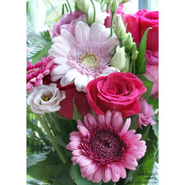 Back of greeting card with close up view of gerbera daisy, roses and lisianthus bouquet