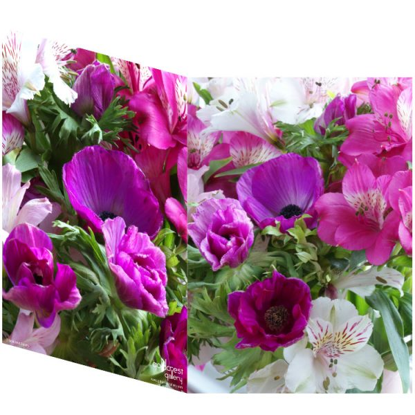 Two sides of a folded greeting card showing two views of purple anemones, pink and white lisianthus and green foliage