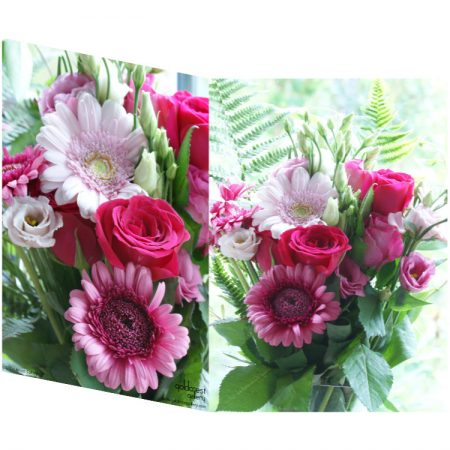 Two sides of a folded greeting card showing two views of a gerbera daisy and roses bouquet