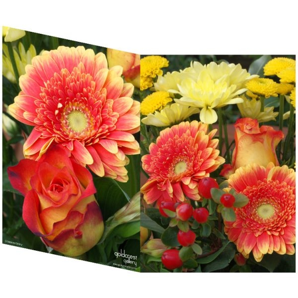 Two sides of a folded greeting card showing two views of yellow, orange and red flowers and red berries